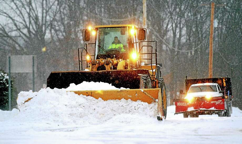 (Arnold Gold-New Haven Register)  A plow clears East Town Rd. in Milford Monday morning 2/2/2015. Photo: Journal Register Co.