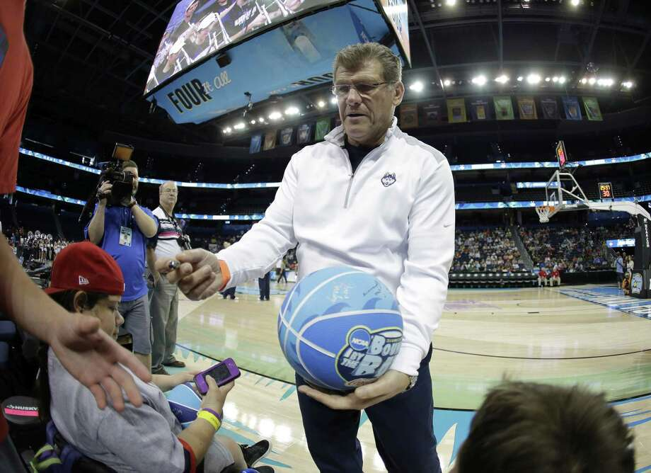 UConn head coach Geno Auriemma signed some autographs at the Final Four on Saturday in Tampa, Fla. But he made headlines on Wednesday when he called the state of men's college basketball a joke. Register sports columnist Chip Malafronte says this is a case of the pot calling the kettle black, but the pot happens to be correct. Photo: Chris O'Meara — The Associated Press   / AP