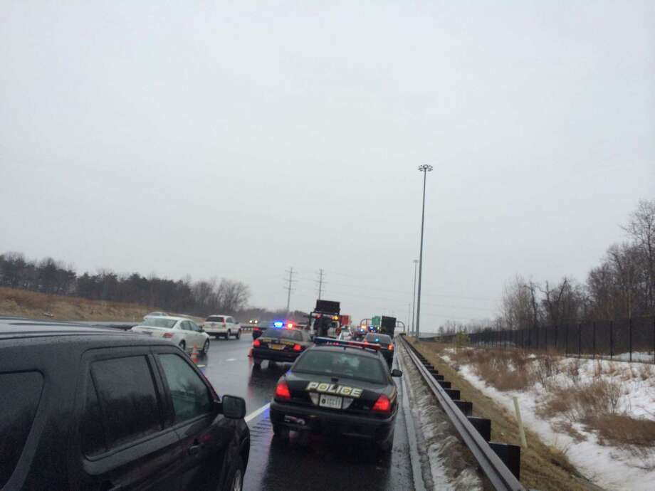 Authorities investigate a shooting incident Tuesday, March 3, 2015, on the Intercounty Connector in Maryland. Police in Maryland are investigating if there are links between a report of shots fired near the headquarters of the National Security Agency and someone firing on an occupied vehicle. In two incidents Tuesday, someone fired on a truck on the Inter-County Connector in Prince Georgeís County. One person was taken to a hospital after being injured by broken glass. Later in the afternoon and about 12 miles away, there was a report of shots fired along the Baltimore-Washington Parkway in Anne Arundel County; the NSA reported damage to a building. No injuries were reported.  (AP Photo/The Washington Post, Dan Morse)  WASHINGTON TIMES OUT; NEW YORK TIMES OUT;THE WASHINGTON EXAMINER AND USA TODAY OUT; MAGS OUT; NO SALES Photo: AP / The Washington Post