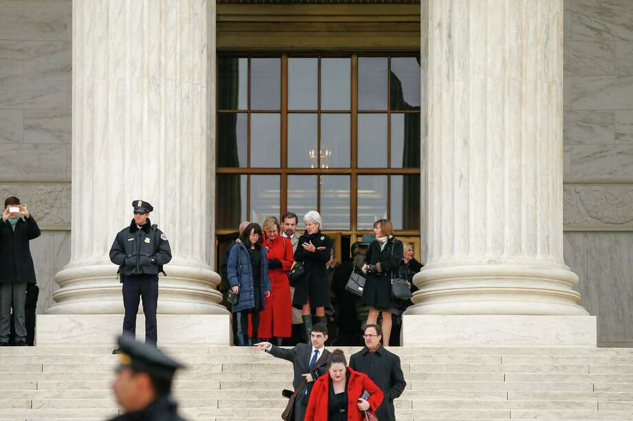 Former Health and Human Services Secretary Kathleen Sebelius, center, exits the Supreme Court in Washington, Wednesday, March 4, 2015. The Supreme Court heard arguments in King v. Burwell, a major test of President Barack Obama's health overhaul which, if successful, could halt health care premium subsidies in all the states where the federal government runs the insurance marketplaces. (AP Photo/Andrew Harnik) Photo: AP / AP