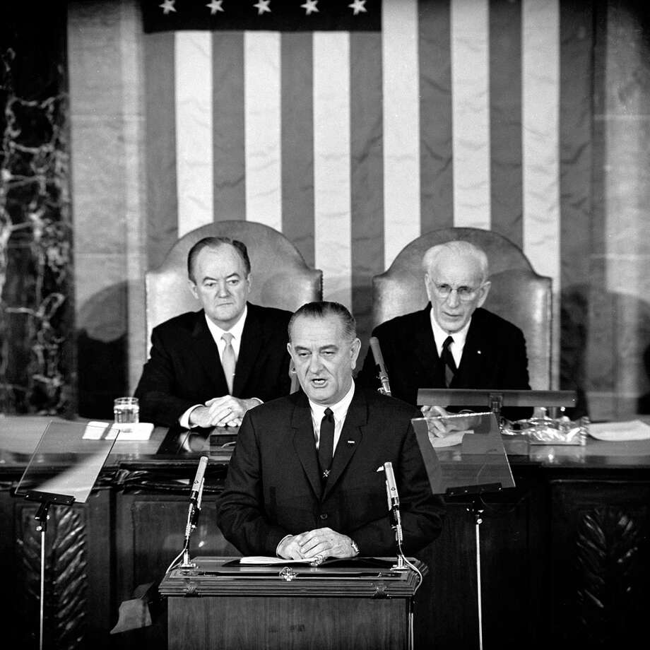 FILE - In this March 15, 1965 file photo, U.S. President Lyndon B. Johnson addresses a joint session of Congress in Washington where he urged the passing of the Voting Rights Act and spoke of his experience as a young teacher in a segregated, Mexican-American school. Vice President Hubert Humphrey is at left and House Speaker John McCormack is at right. (AP Photo/File) Photo: AP / AP