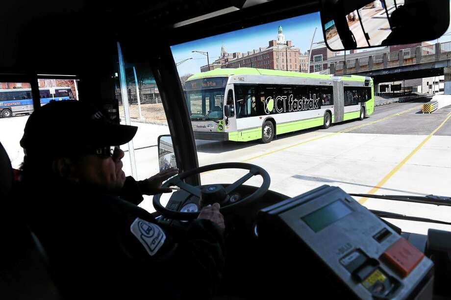CT Fastrak buses cross paths along the 9.4 mile dedicated busway between New Britain and Hartford on 4/2/2015. Photo: (Arnold Gold-New Haven Register)