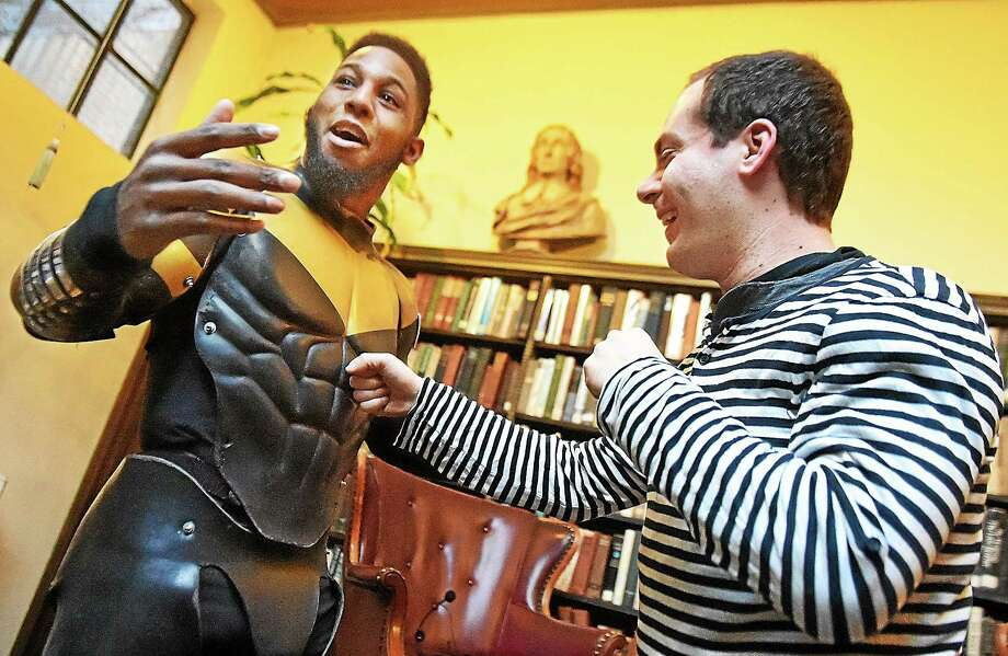 Phoenix Jones demonstrates the impenetrability of his superhero outfit while speaking at the Institute Library iin New Haven. Photo: Catherine Avalone — New Haven Register   / New Haven RegisterThe Middletown Press