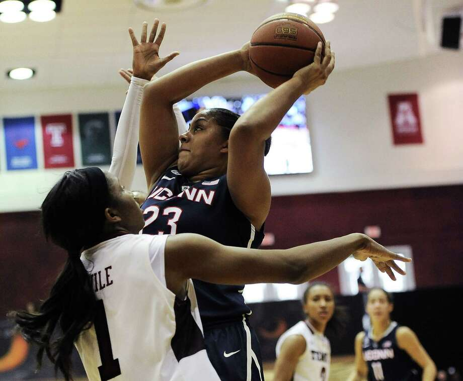 UConn's Kaleena Mosqueda-Lewis (23) looks for room to shoot over Temple's Erica Covile during the first half Sunday in Philadelphia. Photo: Michael Perez — The Associated Press   / AP