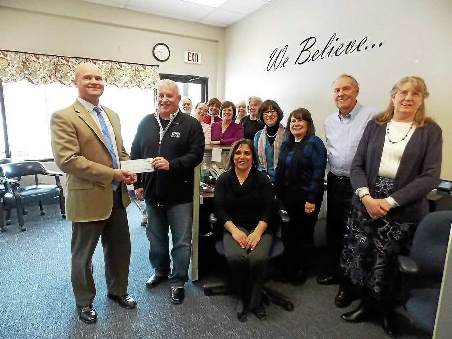 CONTRIBUTED PHOTO  The Coldwell Banker Residential Brokerage office in Oxford recently presented a $1,915 donation to House of Heroes. Photo: Journal Register Co.