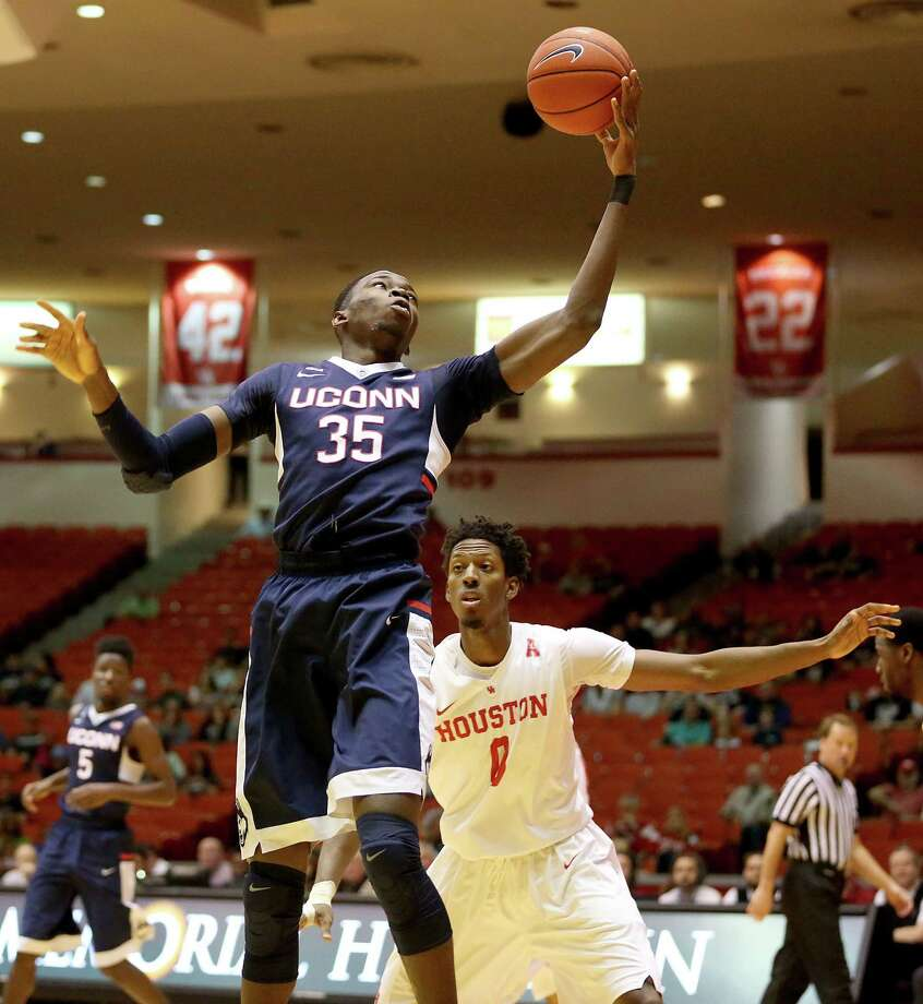 UConn center Amida Brimah (35) grabs a rebound in front of Houston forward Danrad Knowles in the first half Sunday. Photo: The Associated Press   / Houston Chronicle