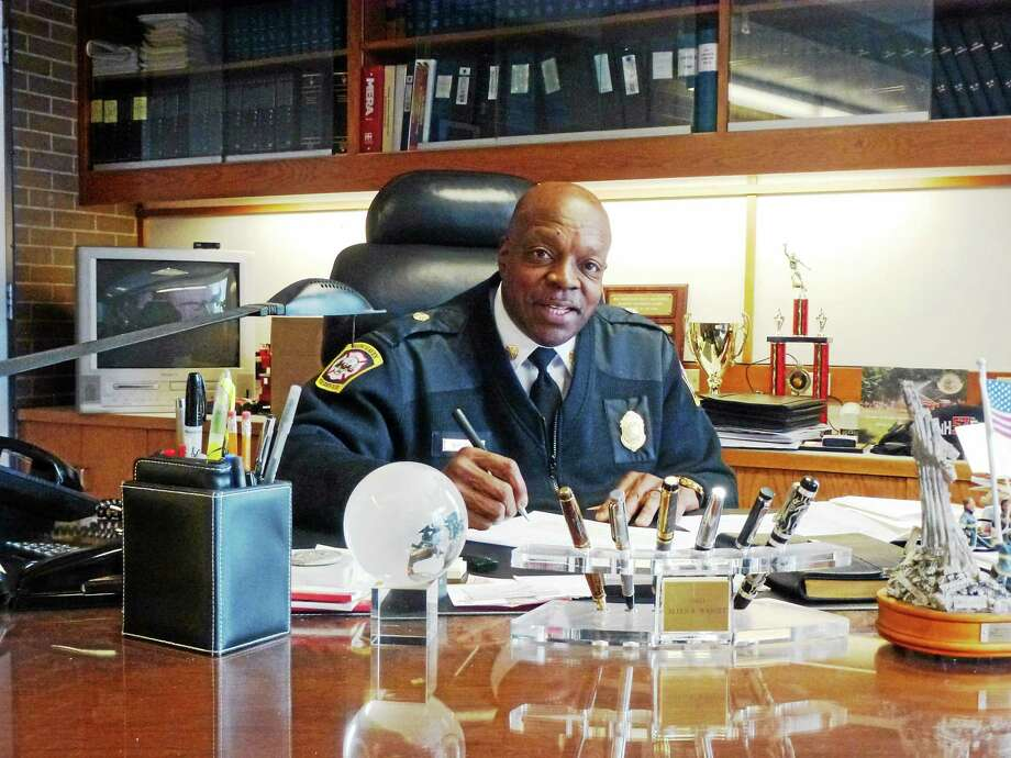 New Haven Fire Chief Allyn Wright at his desk as fire headquarters Photo: (Ryan Flynn - New Haven Register)