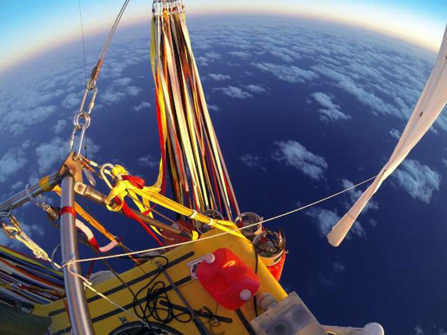 In this Jan. 26, 2015 photo provided by the Two Eagles Balloon Team, the helium-filled ballloon carrying Troy Bradley of Albuquerque and Leonid Tiukhtyaev of Russia crosses the Pacific Ocean after taking off from Saga, Japan. The two pilots landed safely off the coast of Mexico early Saturday, Jan. 31, 2015, after an audacious, nearly 7,000-mile-long trip across the Pacific Ocean that shattered two long-standing records for ballooning. Photo: AP Photo/Two Eagles Balloon Team   / Two Eagles Balloon Team