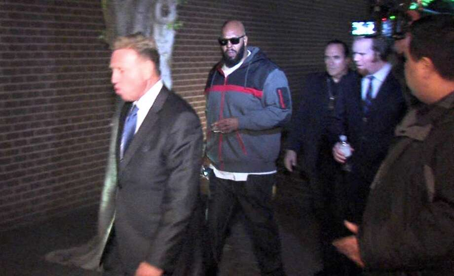 "This image from video shows Death Row Records founder Marion ""Suge"" Knight, right, walking into the Los Angeles County Sheriffs department early Friday morning Jan. 30, 2015 in connection with a hit-and-run incident that left one man dead and another injured. Photo: AP Photo/OnSceneVideo Via AP Television   / OnSceneVideo via AP Television"