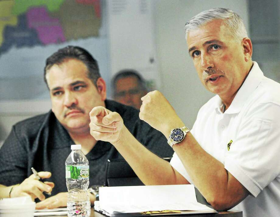 Abe Colon, West Haven's 911 emergency reporting system director, left, and Rick Fontana, New Haven's deputy director of emergency operations, during the CMED Board of Directors meeting Thursday, May 5, 1014, at the South Central Regional Council of Governments offices in North Haven. Photo: (Peter Hvizdak - New Haven Register)   / ©Peter Hvizdak /  New Haven Register