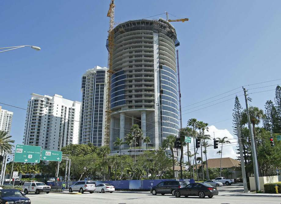 The under-construction Porsche Design Tower in Sunny Isles Beach, Fla. Photo: Joel Auerbach — The Associated Press   / FR170673 AP