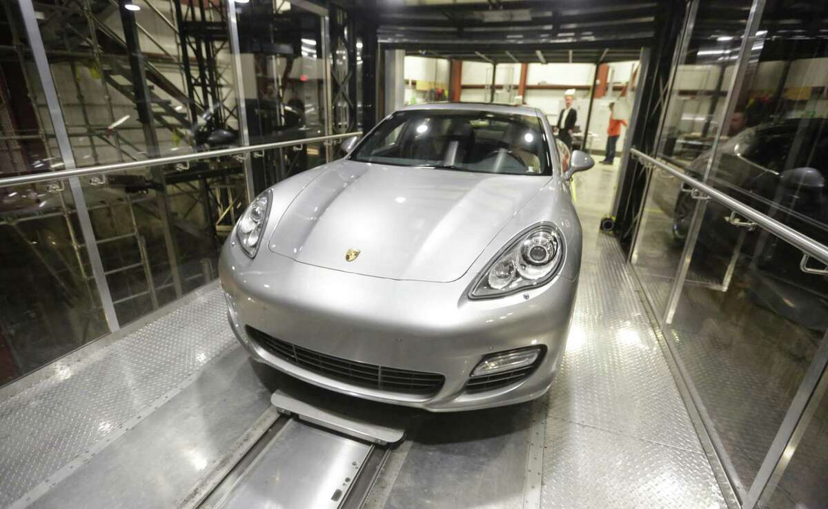 A Porsche Panamera Turbo is used to test the car elevator and parking technology being developed for the Miami-area Porsche Design Tower at Mid-American Elevator Co., in Crest Hill, Ill. Each of the Porsche Design Tower's three car elevators will be able to whisk a vehicle, with its passengers still inside, up 60 stories and then slide it into the owner's personal steel-reinforced garage.