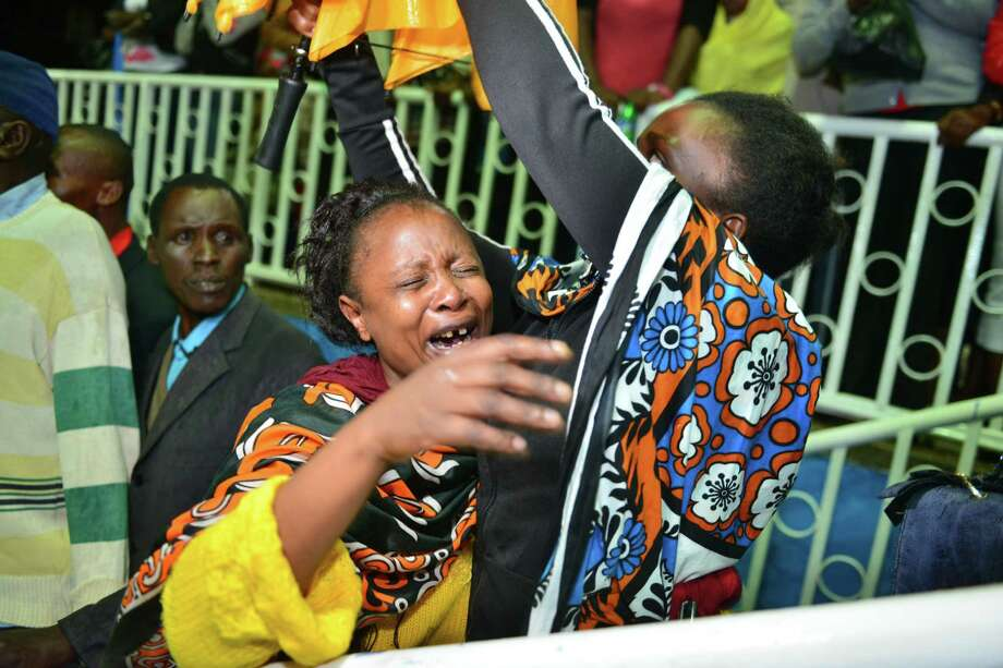 A parent reacts as some 663 students who survived the Garissa University College terror attack arrive in Nairobi Nyayo stadium, Kenya, Saturday April 4, 2015, where their family members were waiting.  Al-Shabab gunmen rampaged through a university in northeastern Kenya at dawn Thursday, killing scores of people in the group's deadliest attack in the East African country, with four militants slain by security forces. (AP Photo) Photo: AP Photo   / AP