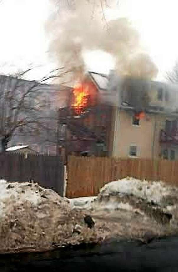 Fire at a home on Winthrip Avenue Wednesday. Photo: Shahid Abdul-Karim/New Haven Register
