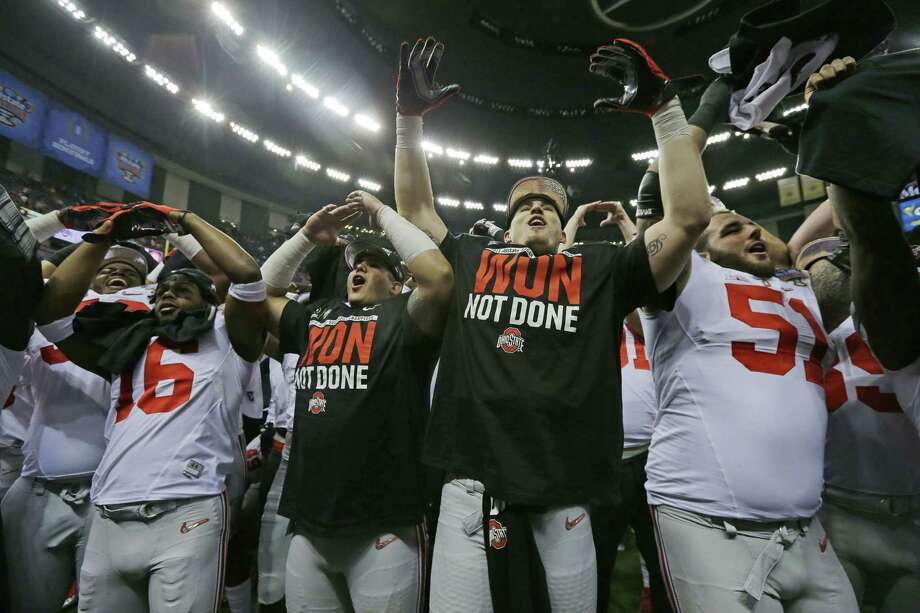 Ohio State players celebrate after their 42-35 Sugar Bowl victory over Alabama on Thursday in New Orleans. Photo: Jamie Martin — The Associated Press   / FR170240 AP