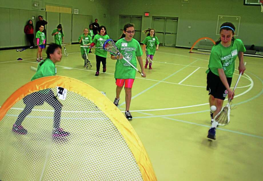 Girls from the community were introduced to several sports Sunday at Hamden Hall Country Day School in honor of National Girls and Women in Sports Day. Photo: CONTRIBUTED PHOTO