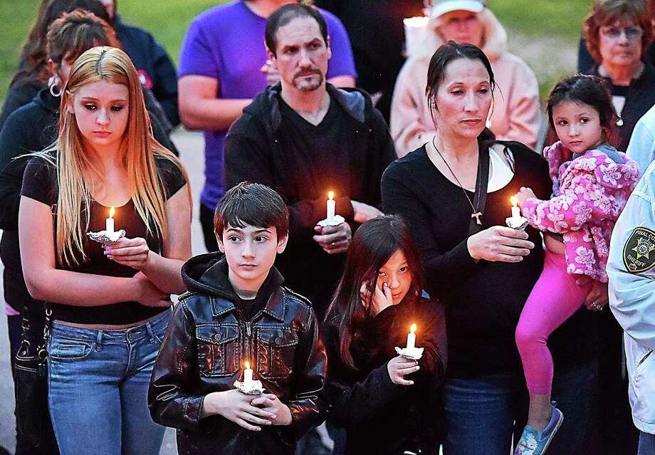 A vigil is held on the East Haven Green Friday for the the two children found dead earlier this week in a home on Strong Street. Photo: Catherine Avalone — New Haven Register      / New Haven RegisterThe Middletown Press