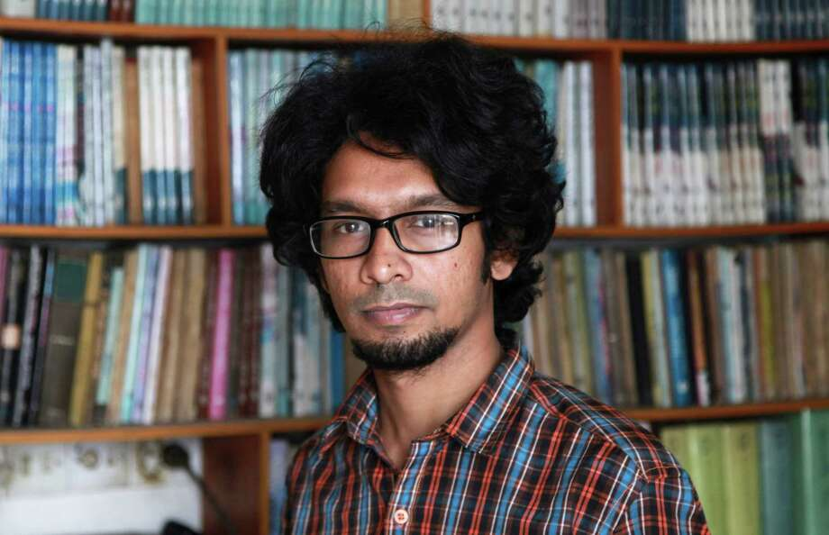 25-year-old Bangladeshi blogger Ananya Azad poses for a photograph at his house in Dhaka, Bangladesh, Saturday, April 4, 2015. Ananya quit his job as a newspaper columnist and stopped writing blogs in recent months after receiving numerous threats for being critical of Islamic fundamentalism and politics driven by religion, but still posts critical comments on Facebook. Photo: AP Photo/ A.M. Ahad   / AP
