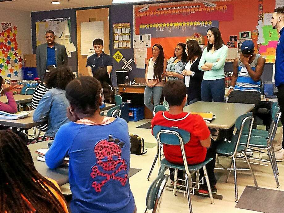 University of New Haven business students mentor Barnard Magnet Middle School students. Photo: Photo Courtesy Of The University Of New Haven