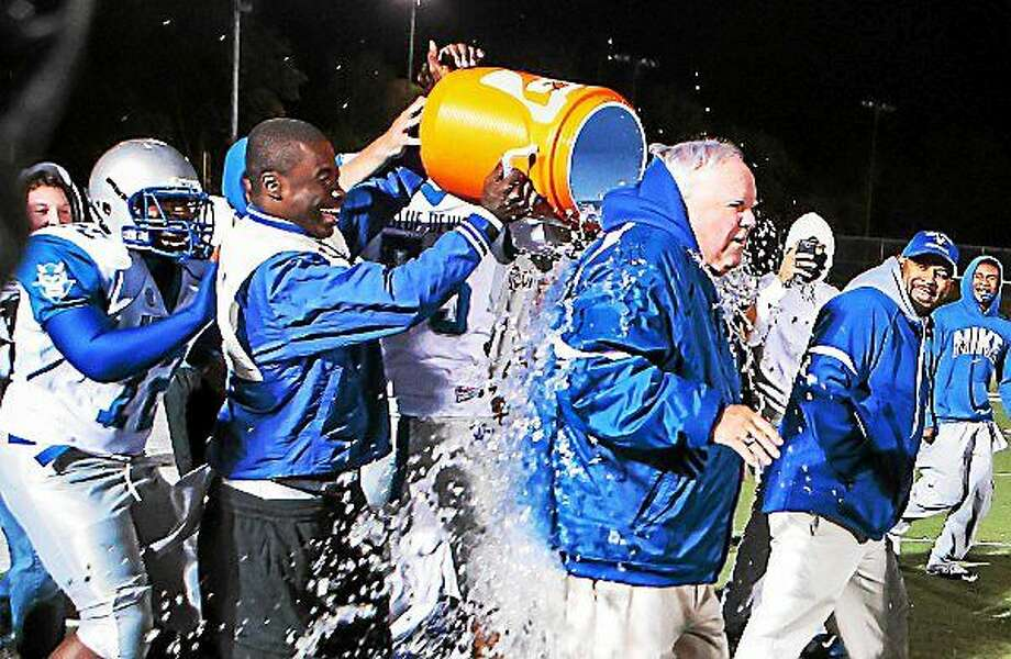 West Haven football coach Ed McCarthy gets an ice bath from his teamís players after defeating Hamden 49-7 in celebration of McCarthyís 322 career win, setting the all-time record in 2013. Photo: Journal Register Co. / John Vanacore