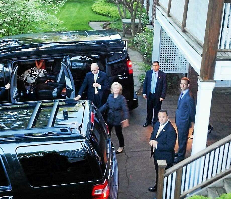 Hillary Clinton leaves a fundraiser at the home of Yale law school professors Judith Resnik and Dennis Curtis in New Haven Friday. Photo: Mary O'Leary — New Haven Register