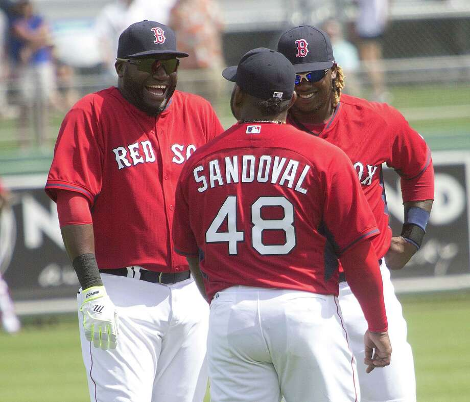 From left, Red Sox players David Ortiz, Pablo Sandoval and Hanley Ramirez chat during Tuesday's game against Northeastern in Fort Myers, Fla. Boston beat both Northeastern and Boston College by one run. Photo: Andrew West — The News-Press   / The News-Press