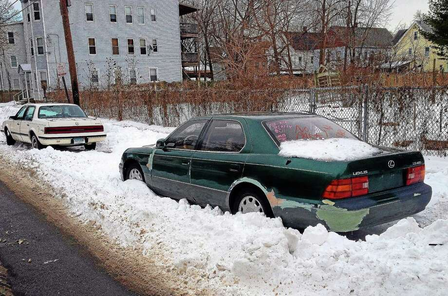 Newhallville residents are petitioning the Board of Alders to increase the neighborhood's resident-only parking zone to keep cars like this one parked on Starr Street from eating up parking spots. Photo: (Evan Lips - New Haven Register)