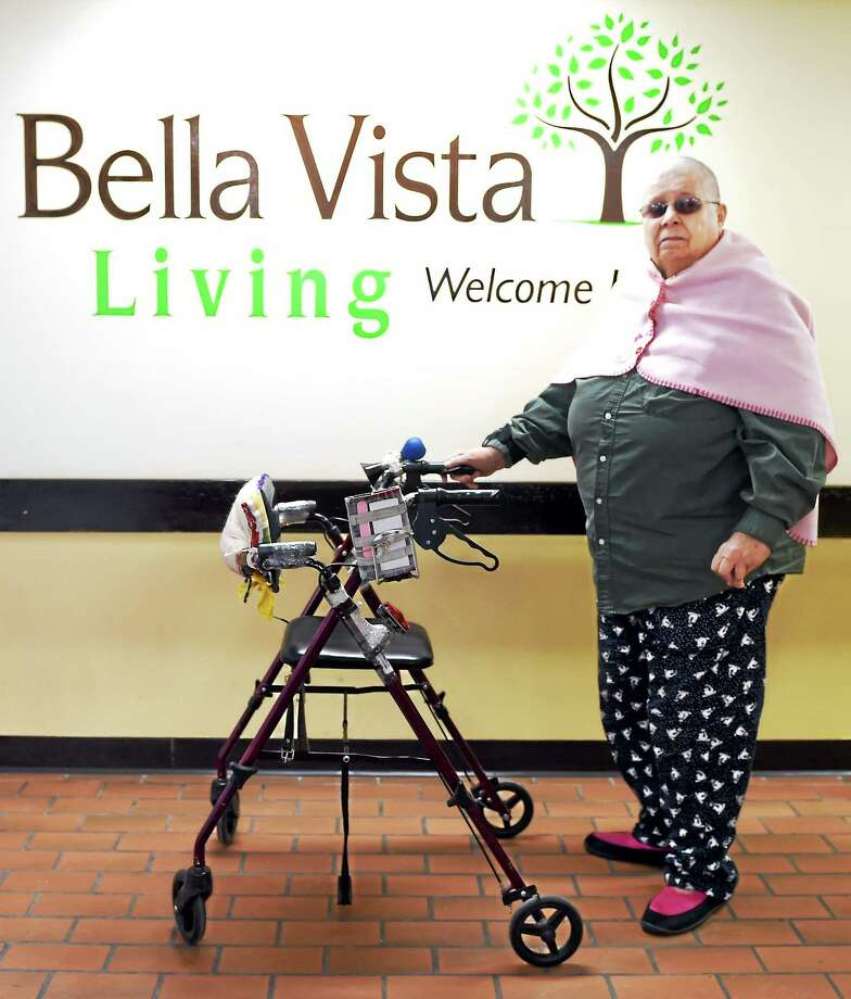 Charlotte Mardis, a Bella Vista building E resident,  would like to ride the CT Transit bus but her walker is made in such a way that it can't be folded. January 30, 2015. Photo: (Peter Hvizdak — New Haven Register)   / ©2015 Peter Hvizdak