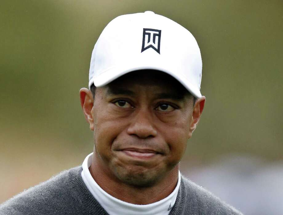Tiger Woods has made up his mind — he will play the Masters. After two trips to Augusta National this week, Woods announced his return to competition on his website on Friday. Photo: Rick Scuteri — The Associated Press File Photo   / FR157181 AP