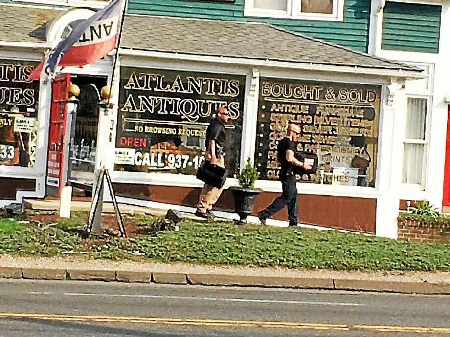 Technicians seen leaving Atlantis Antiques around 5 p.m. Tuesday. Photo: Mark Zaretsky/New Haven Register