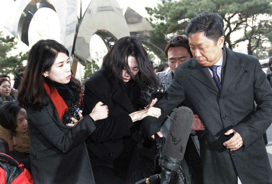 Cho Hyun-ah, center, former vice president of Korean Air Lines, arrives at the Seoul Western District Prosecutors Office in Seoul, South Korea, Dec. 30, 2014. Photo: Ahn Young-joon — The Associated Press   / AP