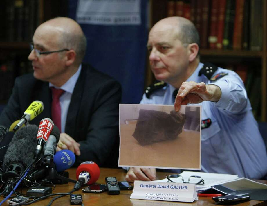 General David Galtier, flanked by Marseille prosecutor Brice Robin, left, displays a picture showing the second black box from the Germanwings plane that crashed in the French Alps last week, during a press conference Thursday in Marseille, southern France. Photo: Associated Press   / AP