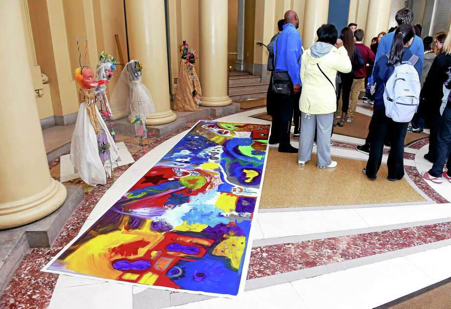 (Arnold Gold-New Haven Register)  An Autism Art Gallery showcasing art made by residents of Chapel Haven in collaboration with Yale students is displayed in the rotunda of Yale University's Woolsey Hall on 4/2/2015. Photo: Arnold Gold — New Haven Register