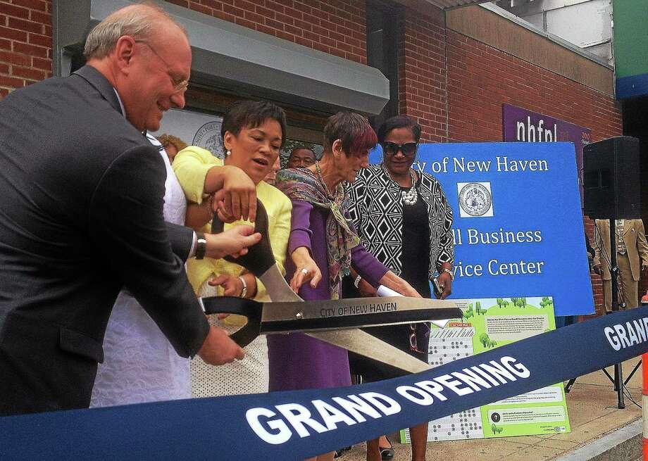 Mayor Toni Harp, U.S. Rep. Rosa DeLauro, New Haven Small Business Service Center Director Jackie James and dozens of others were on hand Tuesday at the opening of the city's new small business academy at 192 Dixwell Ave. Photo: Evan Lips — New Haven Register