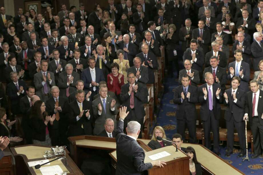 """Israeli Prime Minister Benjamin Netanyahu waves after speaking before a joint meeting of Congress on Capitol Hill in Washington, Tuesday, March 3, 2015. In a speech that stirred political intrigue in two countries, Netanyahu told Congress that negotiations underway between Iran and the U.S. would """"all but guarantee"""" that Tehran will get nuclear weapons, a step that the world must avoid at all costs. (AP Photo/J. Scott Applewhite) Photo: AP / AP"""