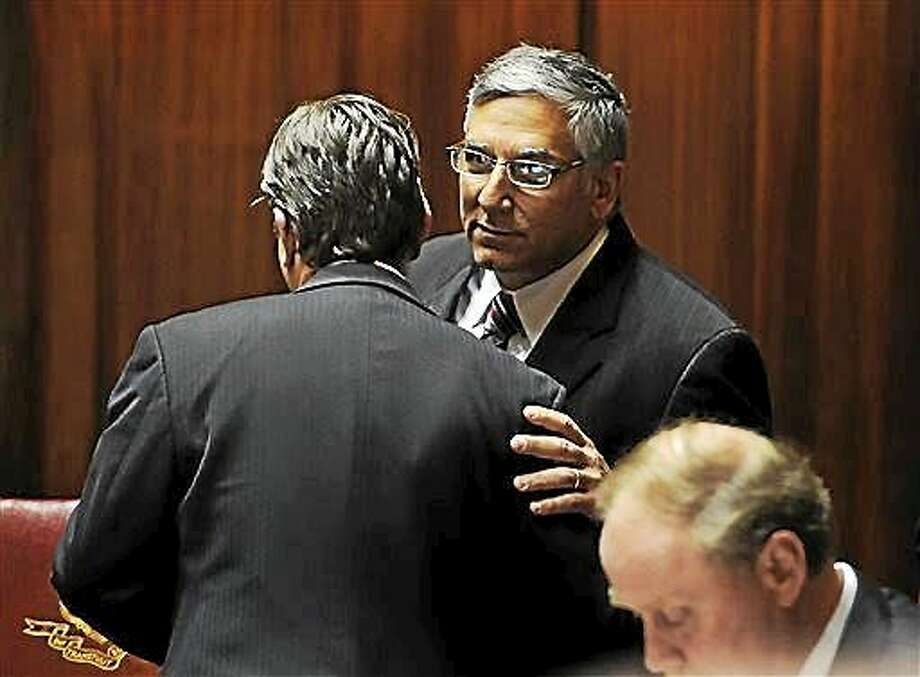 Connecticut Senate Minority Leader Len Fasano, right, R-North Haven, speaks with State Sen. Bob Duff, D-Norwalk, in Senate Chambers at the Capitol on the final day of the session on Wednesday, June 3, 2015 in Hartford, Conn. Photo: AP Photo/Jessica Hill