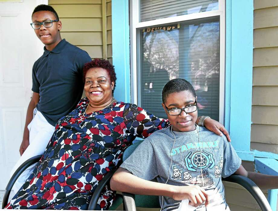 Rajay Linton, right, 14, is home in West Haven Tuesday with his cousin, C.J. King, left, and aunt, Blossom Linton King, after receiving a heart transplant. Photo: Arnold Gold — New Haven Register