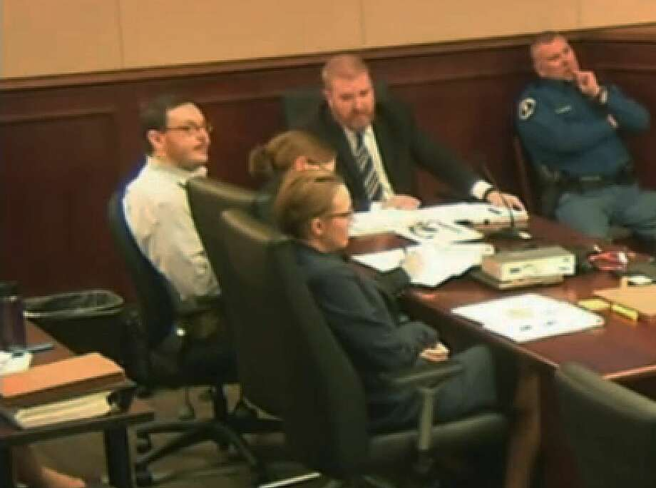 File - In this April 27, 2015 file photo taken from video, Colorado movie theater shooter James Holmes, far left, sits with his defense team during his trial at the Arapahoe County Justice Center, in Centennial, Colo. Homes trial Judge Carlos Samour rejected defense attorneys' second request for a mistrial Wednesday, June 3, 2015, over video shown in court of a psychiatrist's interview with Holmes. (Colorado Judicial Department via AP, Pool, file) Photo: AP / Colorado Judicial Department