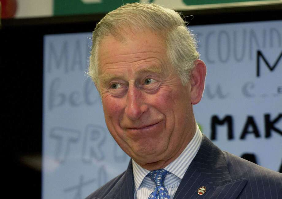 FILE - In this Wednesday, May 13, 2015 file photo, Britain's Prince Charles smiles as he hands out certificates to Prince's Trust 'Mark your Mark participants during a visit to British retailer Marks and Spencer in London. British authorities have released more private letters from Prince Charles to government ministers on topics ranging from historic buildings to hospital food. The letters were the subject of a lengthy legal battle that pitted Charles' right to privacy against the public's right to know. The 17 published Thursday, June 4, 2015 written between 2007 and 2009, include an appeal for funds to preserve the huts used by British Antarctic explorers Ernest Shackleton and Robert Scott. (AP Photo/Alastair Grant, Pool, File) Photo: AP / AP Pool