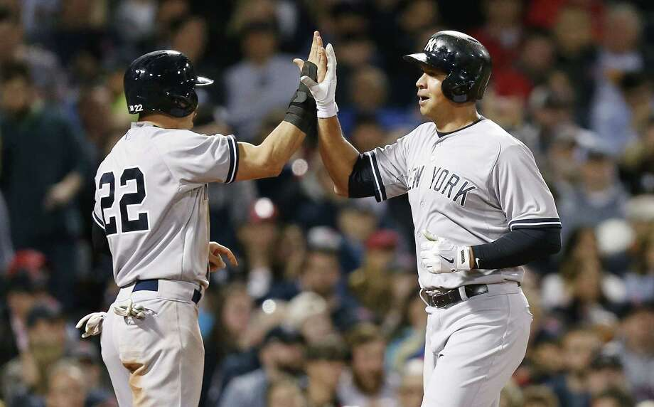 The Yankees' Alex Rodriguez, right, celebrates after scoring with Jacoby Ellsbury on a two-run double by Brian McCann during the third inning on Sunday. Photo: Michael Dwyer — The Associated Press   / AP