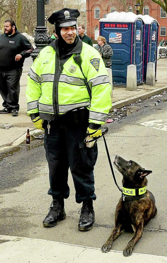 (Peter Hvizdak - New Haven Register)  New Haven Police Officer Lars Vallin with his K-9 partner Xander, a Dutch shepherd working during the New Haven St. Patrick's Day Parade in New Haven, Connecticut, Sunday, March 15, 2015. Photo: ©2015 Peter Hvizdak / ?2015 Peter Hvizdak