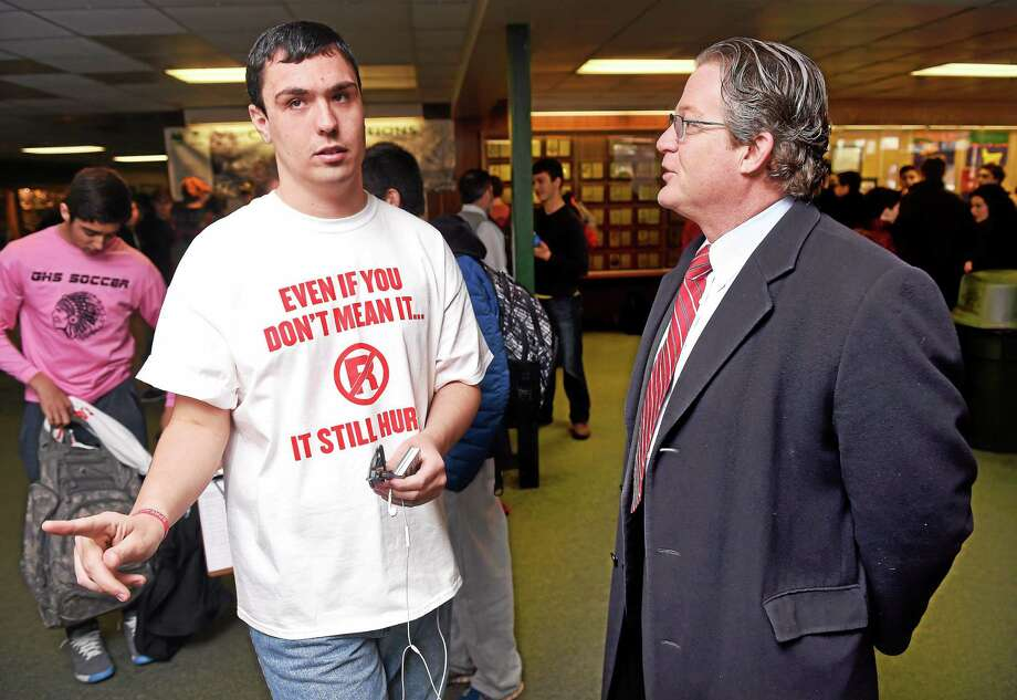 "Guilford High School student Alex Beckett, left, 20, speaks with state Sen. Ted Kennedy Jr. during the ""Spread the Word to End the Word"" campaign in the lobby of Guilford High School Tuesday. Photo: Arnold Gold — New Haven Register"
