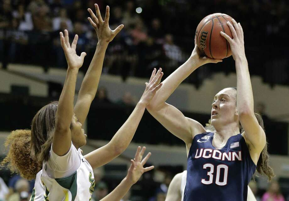 UConn's Breanna Stewart (30) shoots over South Florida's Shalethia Stringfield, front left, and Laura Ferreira during Monday's game in Tampa, Fla. Photo: Chris O'Meara — The Associated Press   / AP