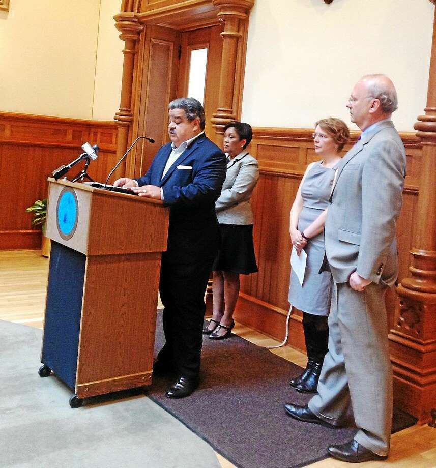 John Padilla of New Paradigms talks about how to increase employment in New Haven. Behind him, from left, are Mayor Toni Harp, Mary Reynolds of New Haven Works and city Economic Development Administrator Matthew Nemerson. Photo: Mary O'Leary — New Haven Register