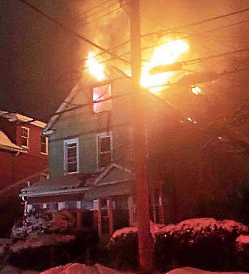 A fire tore through a home at 922 Winchester Ave. in New Haven early Monday morning. All five people inside made it out safely and were being assisted by the Red Cross. Photo: Contributed Photo