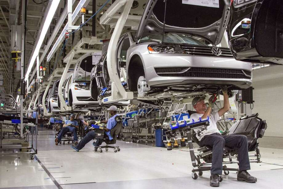 In this July 12, 2013 photo, employees at the Volkswagen plant in Chattanooga, Tenn., work on the assembly of a Passat sedan. Photo: AP Photo/Erik Schelzig, File   / AP