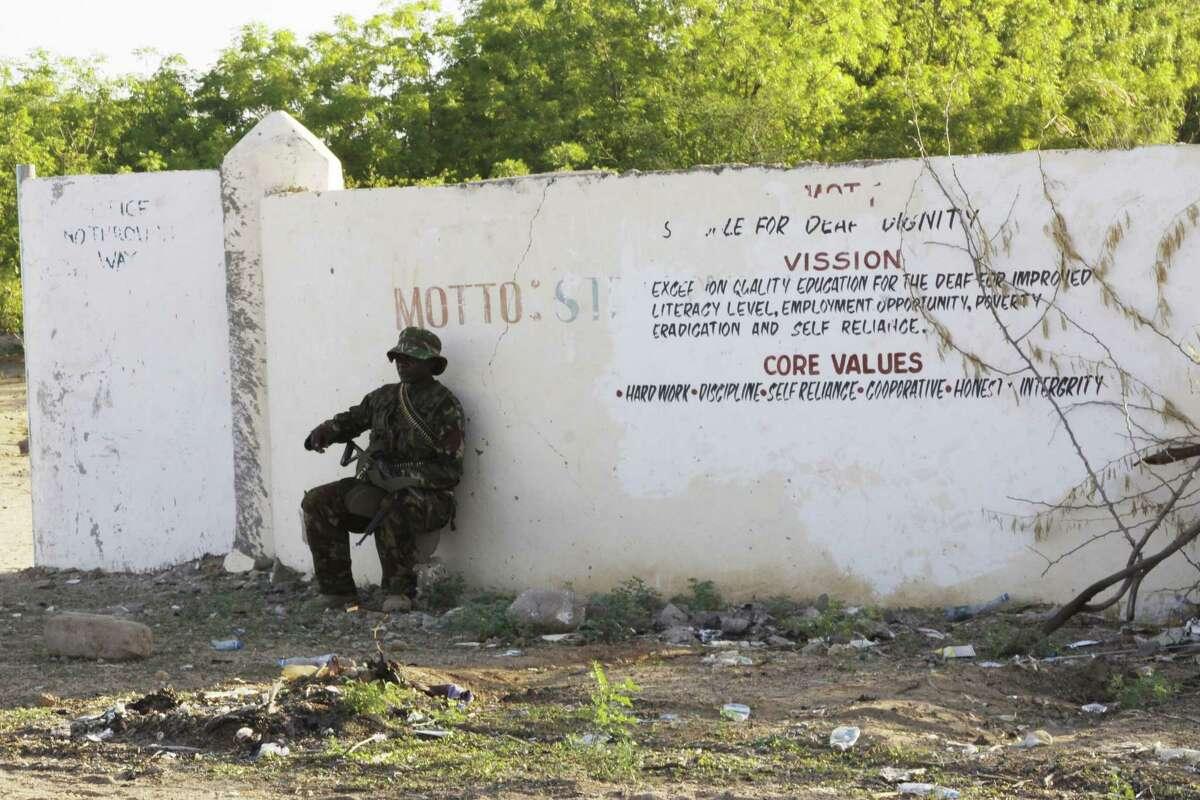 Associated PressA Kenya Defence Forces soldier secures the area around the Garissa University college, in Garissa, Kenya, Thursday.