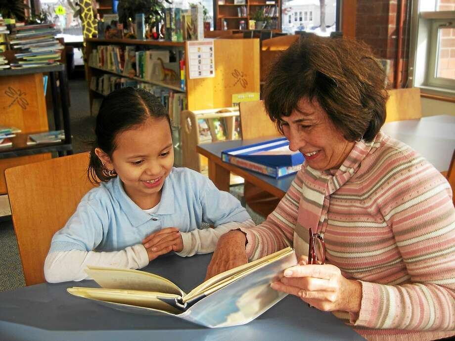 Jewish Coalition for Literacy volunteer Margie Shapiro works with a student. Photo: Contributed