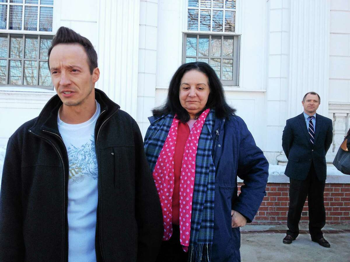 From left, Matthew Ducsay, his mother, Linda Ducsay, and Milford State's Attorney Kevin D. Lawlor outside court Monday following the trial of Matthew Pugh.
