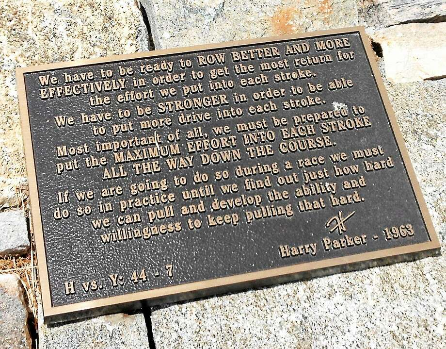 A memorial plaque in honor of the late Harvard crew coach Harry Parker sits outside the Harvard camp in Gales Ferry. Photo: Jim Fuller — Register